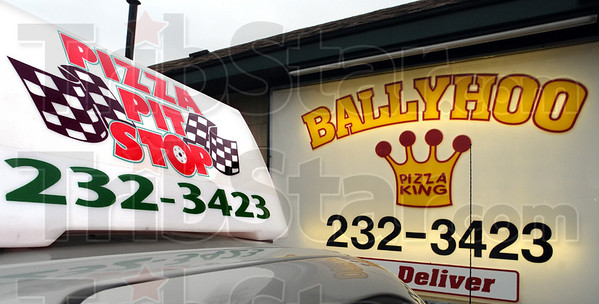 Same number: A new sign on top of a delivery vehicle for Pit Stop Pizza shows the same telephone number as the former Ballyhoo Pizza King business located near 25th and Poplar streets.