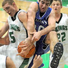 Ball battle: West Vigo's #5, Tyler Wampler and North Vermillion's #40, Lane Clark battle for a loose ball during game action Wednesday night.