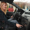 "Tribune-Star/Joseph C. Garza<br /> Just the push of a button: Megan MacRae-Whatman programs the MyKey program in a 2010 Ford Focus as a demonstration Thursday, Oct. 29 in the Tribune-Star parking lot. ""Couple pushes of the button and you're all set,"" said MacRae-Whatman."