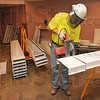Tribune-Star/Joseph C. Garza<br /> Security ceiling: Jonathan Babcock of Whitley Construction out of Kansas City cuts one of the panels that is part of the new security ceiling at the Vigo County jail Wednesday.