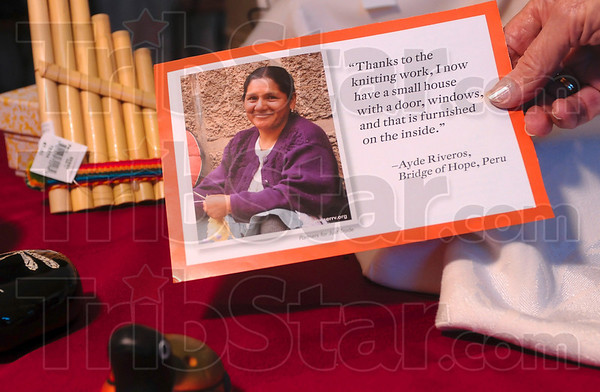 Tribune-Star/Joseph C. Garza<br /> One of the artisans: Central Christian Church member Jane Siebenmorgan places a card which features a Peruvian artisan among handmade items from Peru Wednesday at the church.