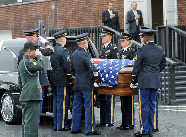 Salute: A military honor guard removes the csket of Sgt. Dale Griffin as he arrives at the funeral home Monday morning.