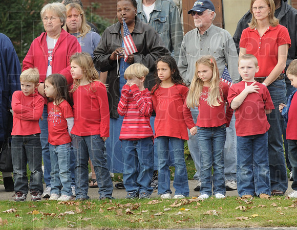 Young Patriots: Children from Maplewood Christian School line the streets to honor Sgt. Dale Griffin as he arrives at the funeral home Monday morning.