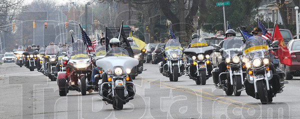 Escort: Members of the Patriot Guard escort the body of Sgt. Dale Griffin as he arrives in Terre Haute Monday morning.