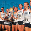 Tribune-Star/Joseph C. Garza<br /> Wildcat winners: Members of the Villanova women's cross country team celebrate after they received the National Champion trophy Monday at the LaVern Gibson Championship Cross Country Course.