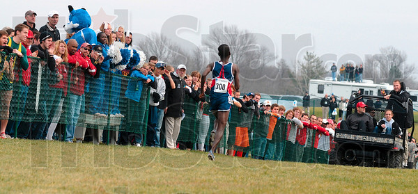 Tribune-Star/Joseph C. Garza<br /> Spectator sport: Fans line the fence to cheer on their favorite team but had to wait for Liberty's Samuel Chelanga pass by first Monday during the men's race of the NCAA Div. I Championship Monday at the LaVern Gibson Championship Cross Country Course.