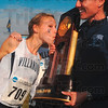 Tribune-Star/Joseph C. Garza<br /> Villanova's Alison Smith kisses the NCAA Div. I Championship National Champion trophy which is held by coach Gina Procaccio Monday at the LaVern Gibson Championship Cross Country Course.