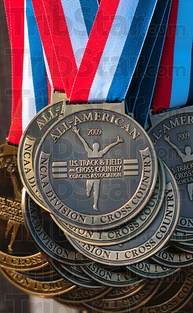For the top 40: Medals hang on the awards stand waiting to placed around the necks of the top 40 finishers in the men's and women's races of the NCAA Div. I Championships Monday at the LaVern Gibson Championship Cross Country Course.
