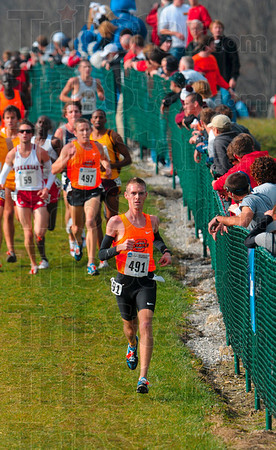 Tribune-Star/Joseph C. Garza<br /> Running for the team title: Oklahoma State's Colby Lowe (491) and teammate Ryan Vail (497) descend down one of the hills Monday at the LaVern Gibson Championship Cross Country Course as they run the 10,000-meter men's race of the NCAA Div. I Championships.