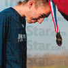 Tribune-Star/Joseph C. Garza<br /> Medal for his mettle: Northern Arizona's David McNeill bows down to accept an All-American medal after the men's 10,000-meter race of the NCAA Div. I Championships Monday at the LaVern Gibson Championship Cross Country Course.