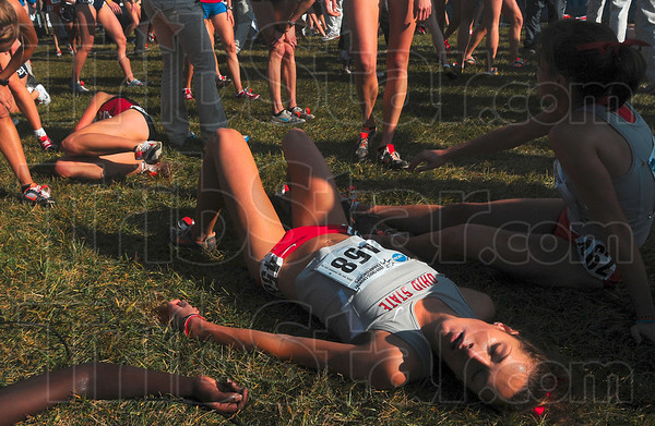 She gave it her all: Ohio State's Jordan Jennewine collapses after crossing the finish line after she ran in the women's 6,000-meter run of the NCAA Div. I Championships Monday at the LaVern Gibson Championship Cross Country Course.