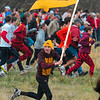 Leading the Gopher charge: A Minnesota fan runs across field Monday at the LaVern Gibson Championship Cross Country Course to follow the Minnesota runners.