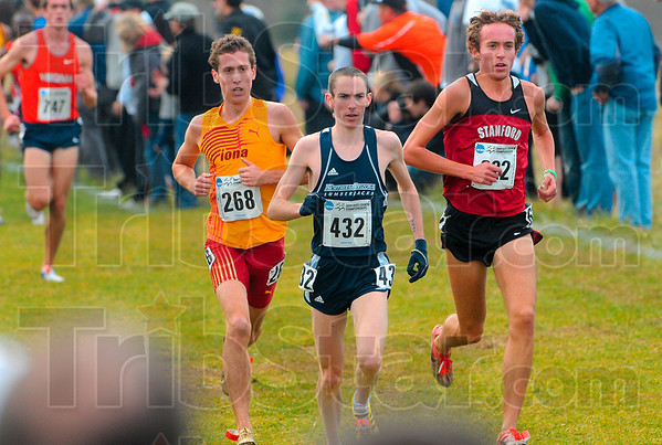 Tribune-Star/Joseph C. Garza<br /> Chasing Chelanga: Iona's Ryan Sheridan, Northern Arizona's David McNeill and Stanford's Chris Derrick chase after Liberty's Samuel Chelanga during the men's 10,000-meter Div. I race of the NCAA Championships Monday at the LaVern Gibson Championship Cross Country Course.