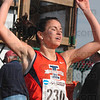 Tribune-Star/Joseph C. Garza<br /> First place finish: Illinois' Angela Bizzarri races her arms in triumph after she finished first in the women's 6,000-meter race of the NCAA Div. I Championships Monday at the LaVern Gibson Championship Cross Country Course.