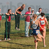 Tribune-Star/Joseph C. Garza<br /> Audience participation: Cross country spectators cheer on Washington's Kendra Schaaf (768) and Illinois' Angela Bizzarri (230) during the women's 6,000-meter race of the NCAA Div. I Championships Monday at the LaVern Gibson Championship Cross Country Course.