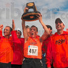 Tribune-Star/Joseph C. Garza<br /> A big yeeeeha!: Members of the men's Oklahoma State cross country team celebrate their first place team finish Monday at the LaVern Gibson Championship Cross Country Course. Raising the trophy is Cowboy Ryan Vail (497).