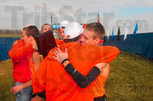 Tribune-Star/Joseph C. Garza<br /> Oklahoma State's Colby Lowe is hugged by coach Dave Smith after the team was presented the first place trophy Monday at the LaVern Gibson Championship Cross Country Course.