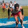 Tribune-Star/Joseph C. Garza<br /> New Mexico's Chris Barnicle falls to the ground as he nears the finish line as competitors stream in behind him during the 10,000-meter men's race of the NCAA Div. I Championships Monday at the LaVern Gibson Championship Cross Country Course.