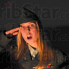 """Tribune-Star/Joseph C. Garza<br /> A song for those who served: Sarah Scott Middle School seventh-grader Allison Kittell salutes as she sings Wade Winston's """"American Fighting Soldier"""" with several of her fellow students during the Veterans Day program at the middle school Tuesday."""