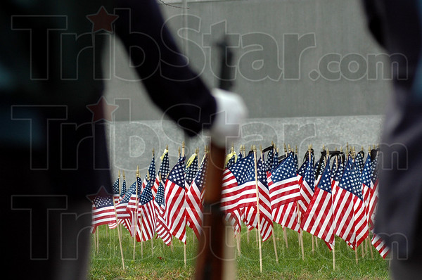 Field of Flags: A veteran stands at parade-rest during Tuesday's ceremony at the Rockville Correctional Facility Tuesday afternoon.
