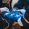 Tribune-Star/Joseph C. Garza<br /> Honoring those that defend it: Members of the 181st Intelligence Wing Honor Guard work in unison to fold the flag during a ceremony Tuesday at Honey Creek Middle School.
