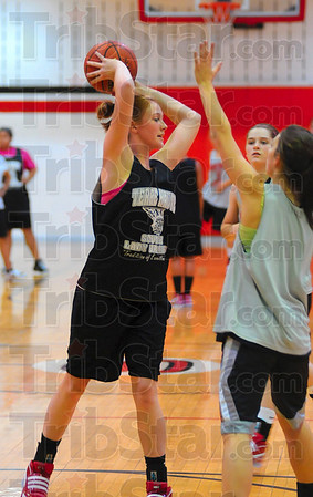 Tribune-Star/Joseph C. Garza<br /> Moving around the perimeter: Terre Haute South's Hannah Lee looks for an open teammate during team practice Tuesday at South.