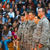 Tribune-Star/Joseph C. Garza<br /> A round of applause: Members of the 181st Intelligence Wing, including 1st Lt. Chris Brownell, right, and members of law enforcement receive a round of applause for their service from students at Honey Creek Middle School Tuesday at the school.