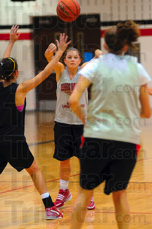 Tribune-Star/Joseph C. Garza<br /> Found an open teammate: Terre Haute South's Elizabeth Vollarth finds an open teammate to make a pass to during team practice Tuesday at South.