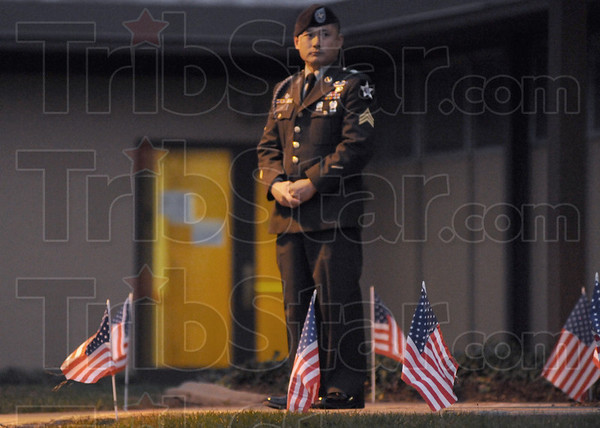 Escort: Sgt. Jason Bae stands outside the Church of Latter Day Church during a visitation for Sgt. Dale Griffin Tuesday evening. Bae is military escort for Griffin.