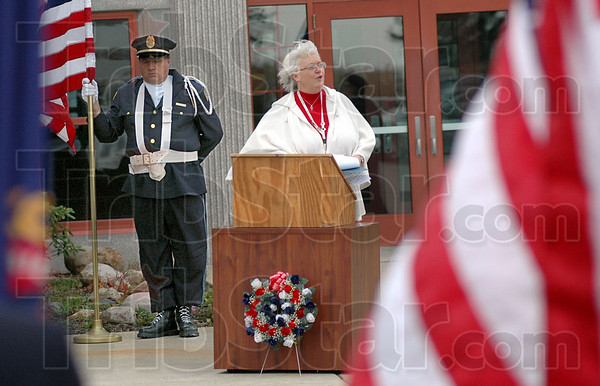 Flags:  Community service director Rita Steed thanks veterans for their service during Tuesday's Field of Flags Vererans' Day 2009 event at the Rockville Correctional Facility.