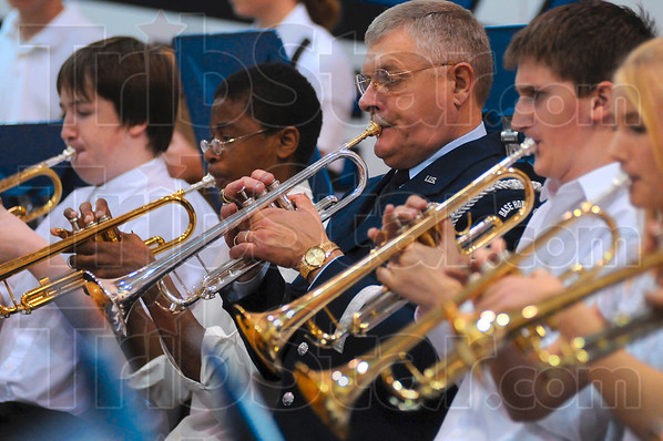 Tribune-Star/Joseph C. Garza<br /> Band veteran: Jim Chesterson, center, retired command chief master sergeant for the Indiana Air National Guard, performs with Honey Creek Middle School band members during a Veterans Day celebration Tuesday at the school.