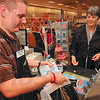 Tribune-Star/Joseph C. Garza<br /> For her Palin fans: Books-A-Million book seller Ray Butler places two copies of Sarah Palin's new book, Going Rogue, in a bag for customer, Marilyn Bahney, of Clay City, Tuesday at the book retailer. Bahney bought one copy for her son and one for her daughter-in-law.