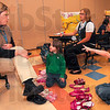 Tribune-Star/Joseph C. Garza<br /> Learning about pairs: Franklin Elementary kindergartner, Mason Meeks-Johnson, right, names something that comes in pairs, like Indiana State student Sarah Burnett's eyes, left, as Mason's classmate, Chloe Bennett, and Burnett's classmate, Kara Austin, look on Tuesday at the school.