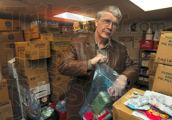Tribune-Star/Joseph C. Garza<br /> Feeding the hungry little ones: Jim Edwards, program director of Ryves Youth Center at Etling Hall,  will use the grant from the Terre Haute Rotary Club to maintain a backpack program that will send food home with children who won't be able to use the hall's kitchen on the weekends when it is closed.