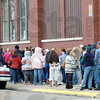 Line: A long line forms at the entrance to the Light House Mission Tuesday afternoon as Thanksgiving basket recipients line up to get their items.