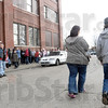 Mission line: Long lines formed at the entrance to the Light House Mission Tuesday as Thanksgiving food baskets were being distributed.