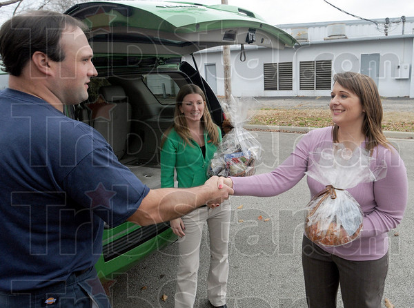 Thank you: Terre Haute firefighter Brock Marietta introduces himself to Servpro representatives Jenny Desanto and Tawnya Riggins Tuesday afternoon at 26th and Maple fire station #11. The ladies provided a Thanksgiving day food basket for the crews that will work that day.