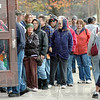 On a mission: A long line forms at the entrance to the Lighthouse Mission as people wait to pick up a Thanksgiving food basket.