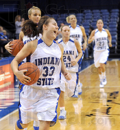 Happy to be home: Kelsey Luna leads the Sycamore women onto the floor Tuesday night with a big smile on her face.