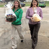 Food delivery: Servpro representatives Jenny Desanto and Tawnya Riggins deliver a Thanksgiving Day food supply for firefighters at the 13th and Ft. Harrison fire station #7.