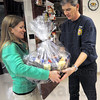 Feast food: Jenny Desanto of Servpro delivers a Thanksgiving Day food basket to Captain John Long at fire station #7 Tuesday morning.