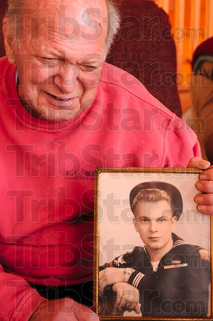 Tribune-Star/Joseph C. Garza<br /> The young sailor from Milwaukee: Hospice patient and Milwaukee native Howard Benthien figures he was 18 years old when this photo was taken of him during his time in the Navy.