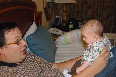 Daddy talking to baby