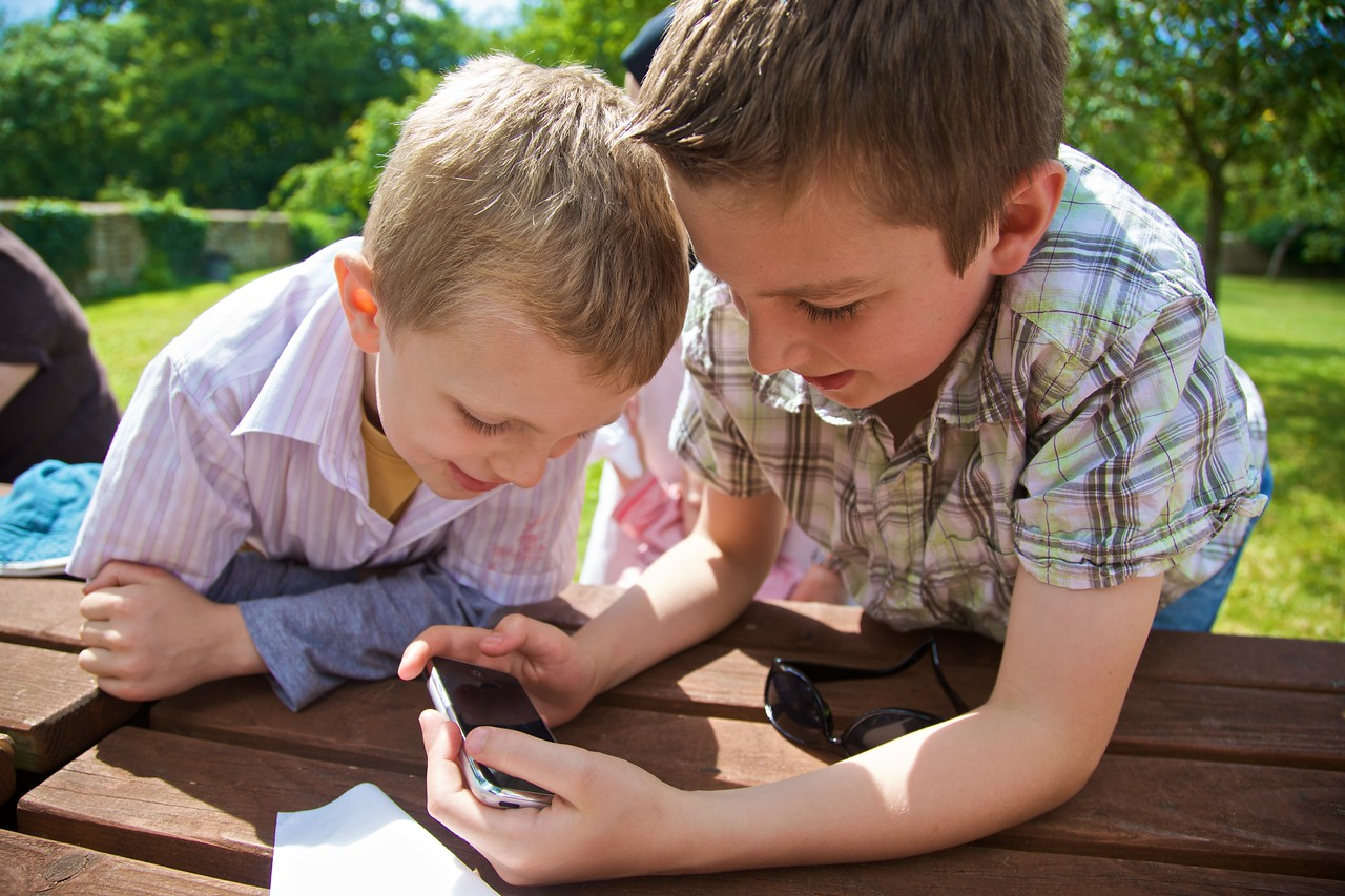 "George and Francis playing <a href=""http://richardflynn.net/notebook/entry/five-ways-in-which-the-iphone-game-flight-control-differs-from-a-real-world/"" title=""Five ways in which the iPhone game Flight Control differs from a real-world job in Approach Control † Notebook † Richard Flynn :: no comment"">Flight Control</a> at Cogges Farm Museum."