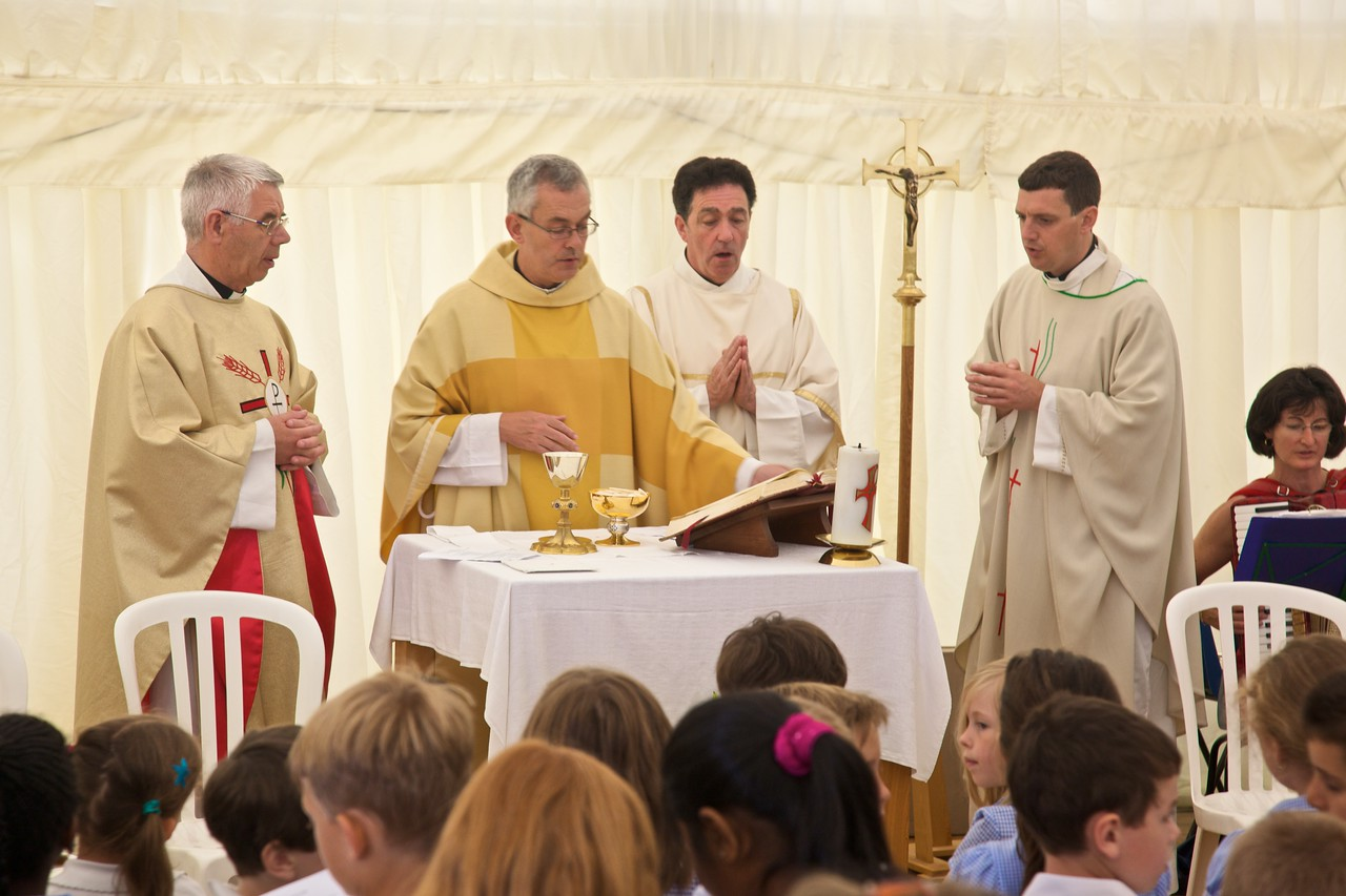 Fr Pat Armstrong, Canon Tom Farrell, Frank Ryan, and John during the Eucharistic Prayer for the 50th Anniversary of the foundation of Our Lady of Lourdes school, Witney.