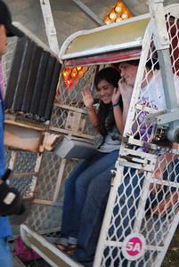 "Gaby Hooker and Matthew Caramenico get locked in on the ""Zipper"" at the fair."