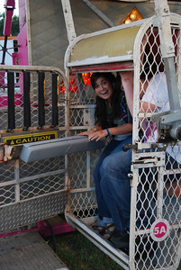 "Gaby Hooker and Matthew Caramenico take their turn at the ""Zipper"" at the Cleveland County fair."