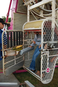 "Sarah Steadman and Taylor Doolittle get on the ""Zipper"" at the Cleveland County Fair."
