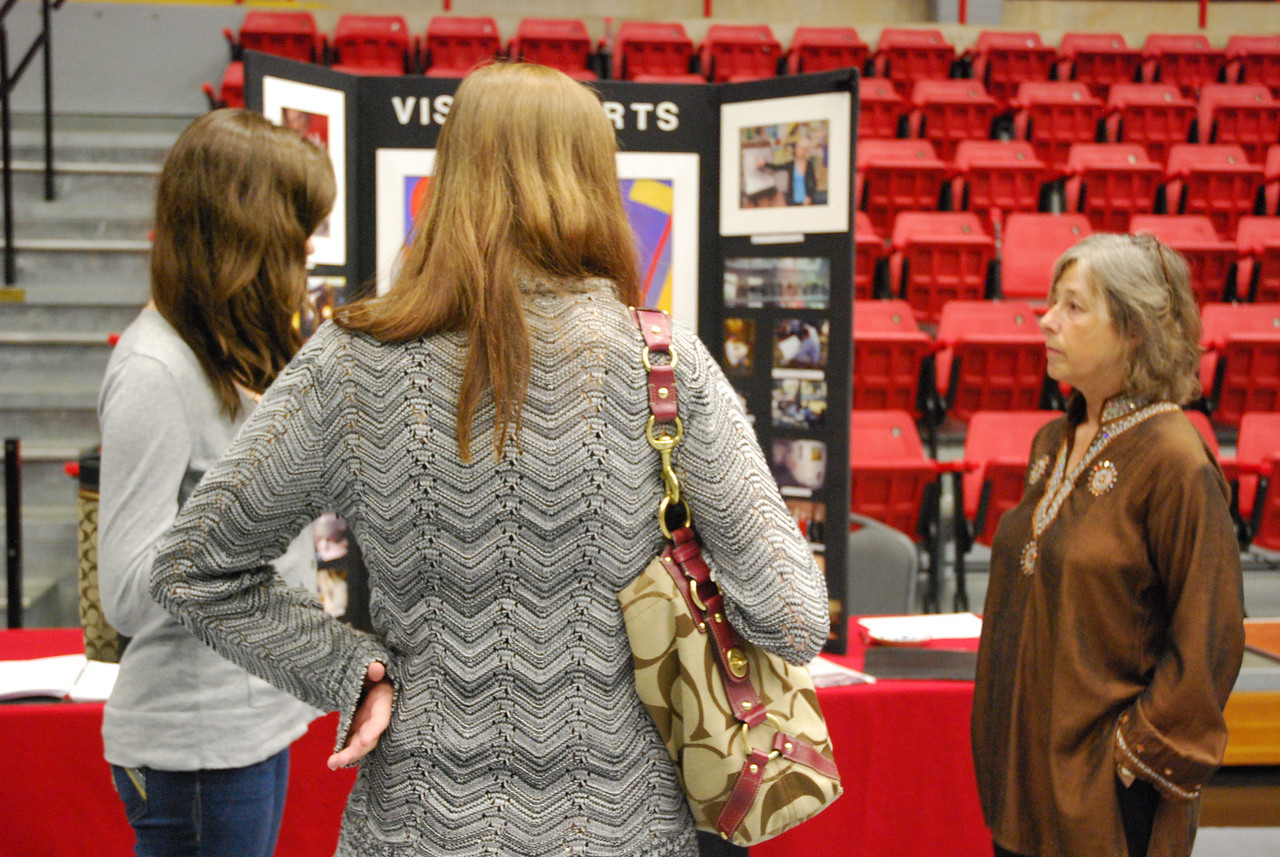 At the faculty fair, Dr. Bottoms talks about the visual arts programs at GWU.