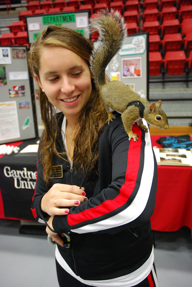 """Freshmen representative, Michelle Palacio, multitasks at the faculty fair being the """"squirrel wrangler"""" and talking to future students about Honor Students Association."""